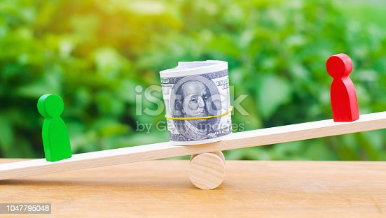 1018458132istockphoto wooden figures of people on scales and dollars between them. a dispute between two businessmen. trial. debt restructuring. wage arrears. protection of employee rights. court. Labor Law. court 1047795048