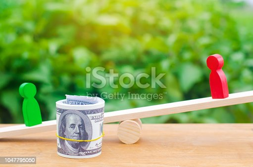 1018458132istockphoto wooden figures of people on scales and dollars between them. a dispute between two businessmen. trial. debt restructuring. wage arrears. protection of employee rights. court. Labor Law. court 1047795050