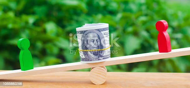 1018458132istockphoto wooden figures of people on scales and dollars between them. a dispute between two businessmen. trial. debt restructuring. wage arrears. protection of employee rights. court. Labor Law. court 1055880258