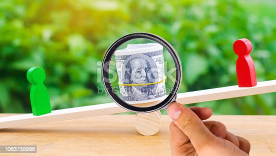 1018458132istockphoto wooden figures of people on scales and dollars between them. a dispute between two businessmen. trial. debt restructuring. wage arrears. protection of employee rights. court. Labor Law. court 1063735996