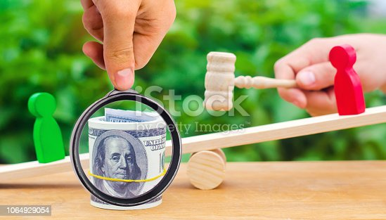 1018458132istockphoto wooden figures of people on scales and dollars between them. a dispute between two businessmen. trial. debt restructuring. wage arrears. protection of employee rights. court. Labor Law. court 1064929054