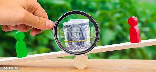 1018458132istockphoto wooden figures of people on scales and dollars between them. a dispute between two businessmen. trial. debt restructuring. wage arrears. protection of employee rights. court. Labor Law. court 1064932180