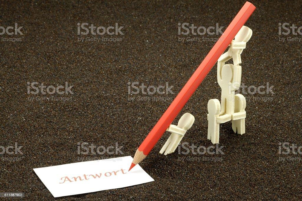 Wooden figures write stock photo