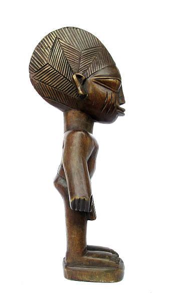 Wooden figurine African stock photo