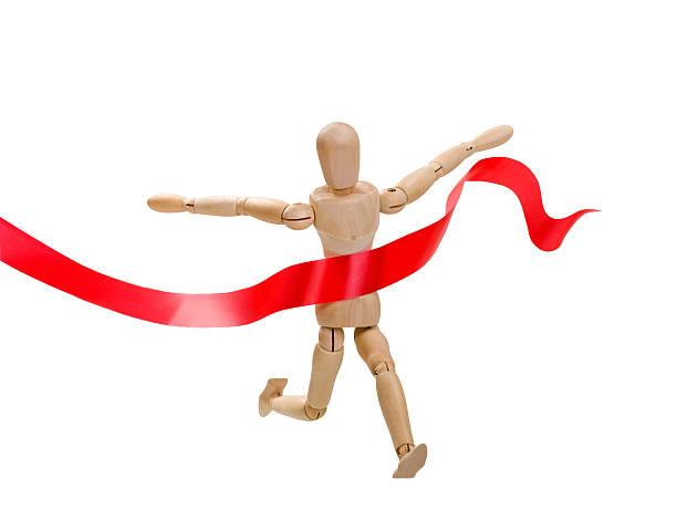 super popular 15cba e97a9 ... finish line ribbon videos, · Wooden figurine of a leading man stock  photo