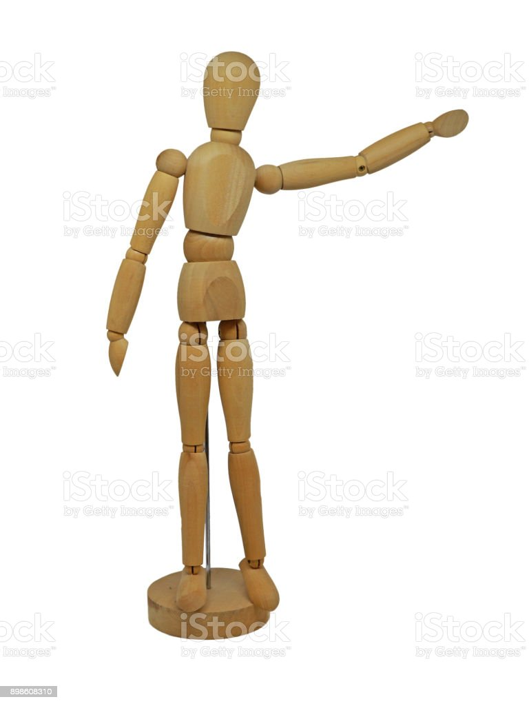 Wooden Figurine with Arm Pointing Isolated on White Background stock photo