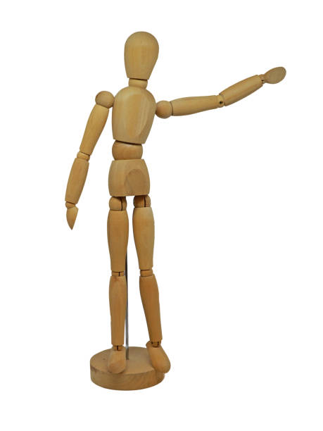 Wooden Figurine with Arm Pointing Isolated on White Background Closeup of isolated wooden figurine ventriloquist's dummy stock pictures, royalty-free photos & images