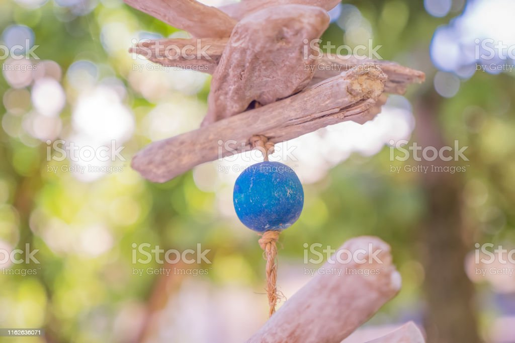 Wooden ball with park on background. Wooden mobile of blue ball....