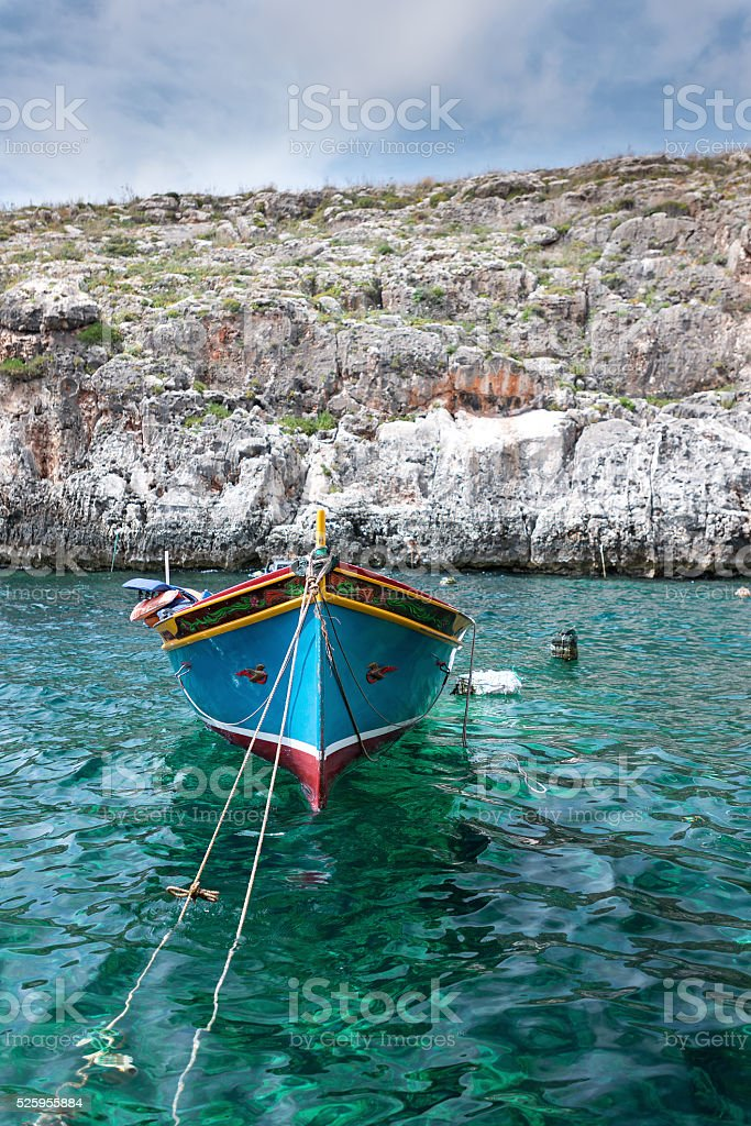 Wooden fishing boat at Gozo island front view stock photo