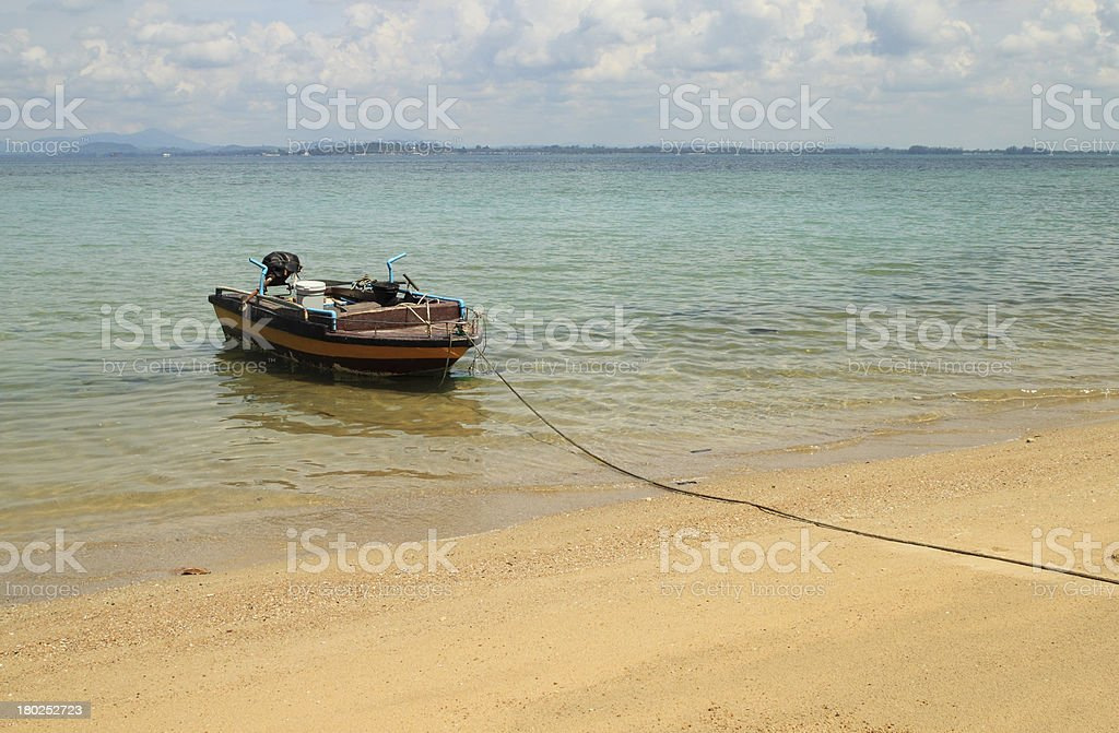 wooden fishing boat landing on the beach royalty-free stock photo