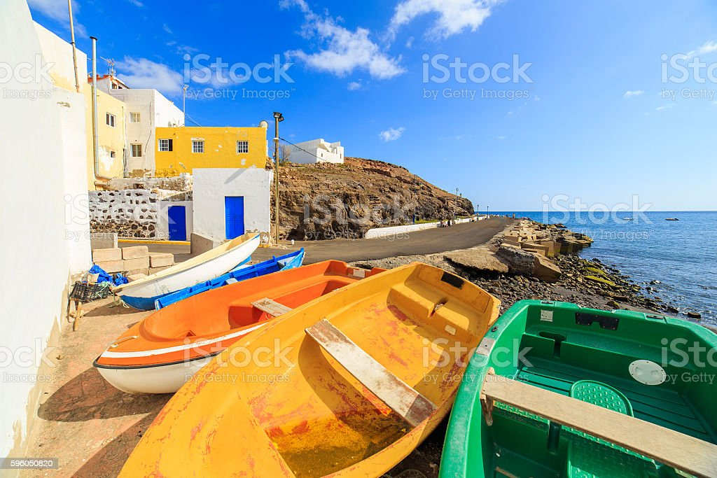 Wooden fishing boats in a small port stock photo