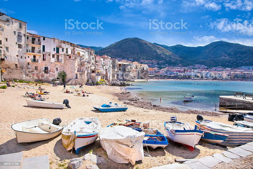 Wooden fishing boats on the old beach of Cefalu, Sicily stock photo