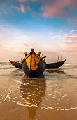 Wooden Fishing Boats anchored at the seashore.