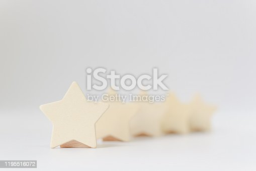 1133580311 istock photo Wooden five star shape on white background. The best excellent business services rating customer experience concept 1195516072