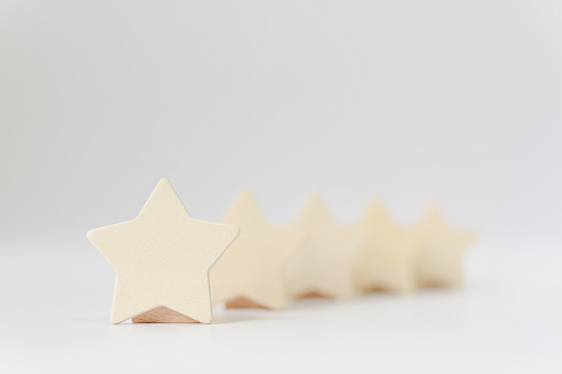 917079212 istock photo Wooden five star shape on white background. The best excellent business services rating customer experience concept 1195516072