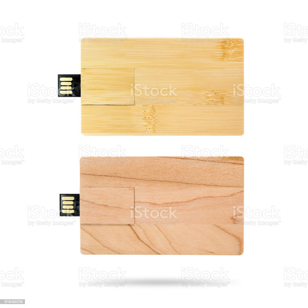 Wooden flash drive isolated on white background. USB stick made from...