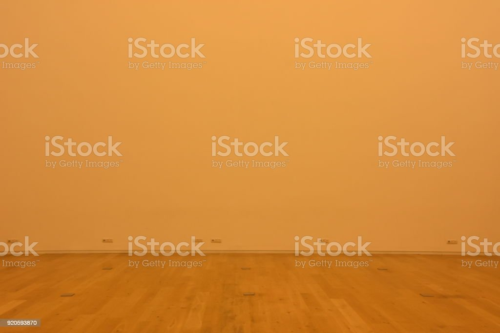 wooden floor and an empty wall
