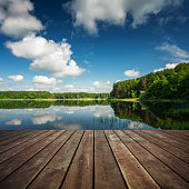 Wooden floor and beautiful lake on the background