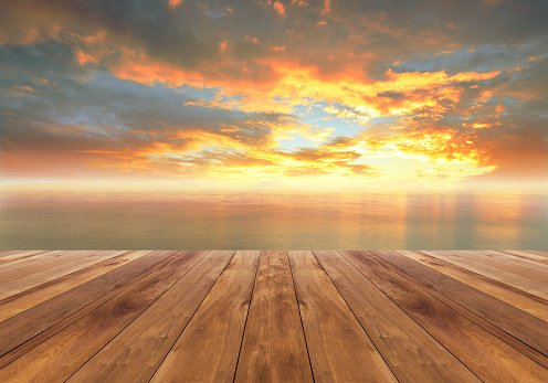 wooden floor and beautiful sunrise