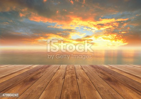 istock wooden floor and beautiful sunrise 475904242