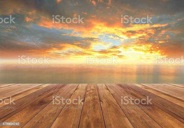 Photo of wooden floor and beautiful sunrise