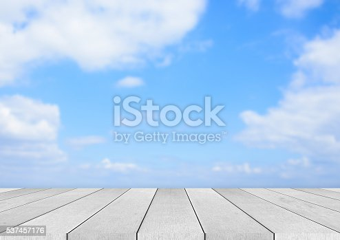 677933036 istock photo wooden floor and blue sky background 537457176
