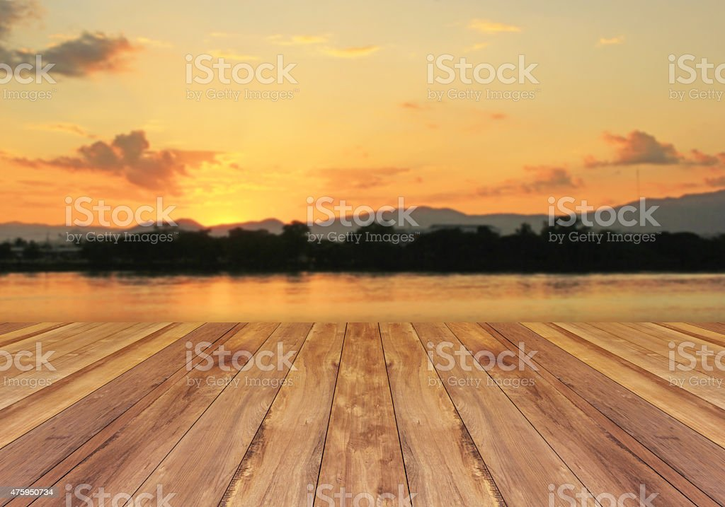 Wooden floor and sunset background stock photo