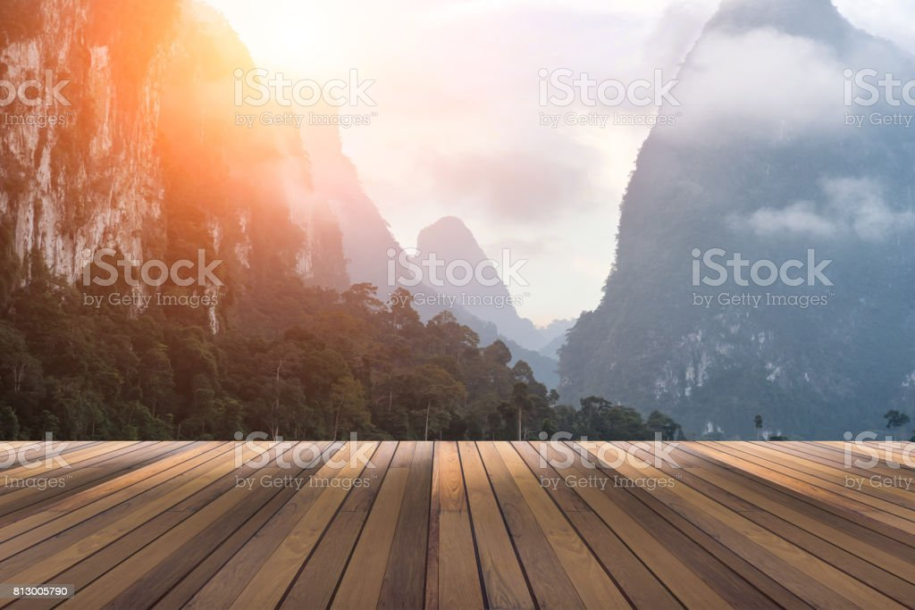 wooden floor and view of bay mountain and sun in background space for your text or object in photo stock photo
