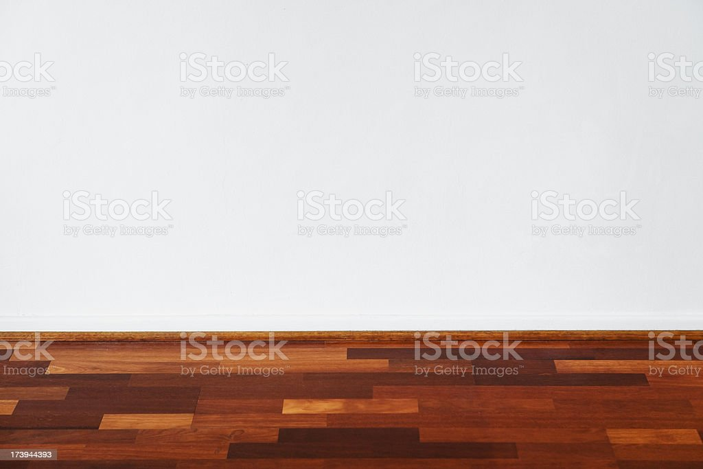 Wooden floor and white wall royalty-free stock photo