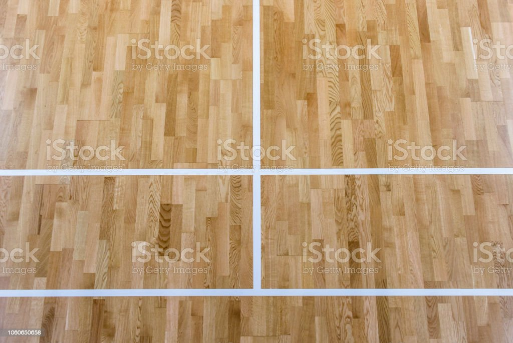 wooden floor badminton court and nets. Wooden floor of sports hall...
