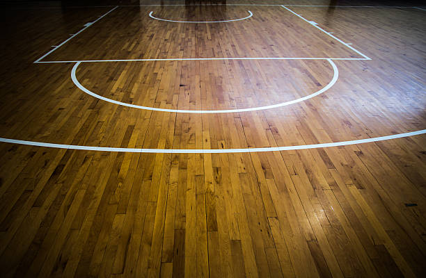 wooden floor basketball court - basketball ball stock photos and pictures