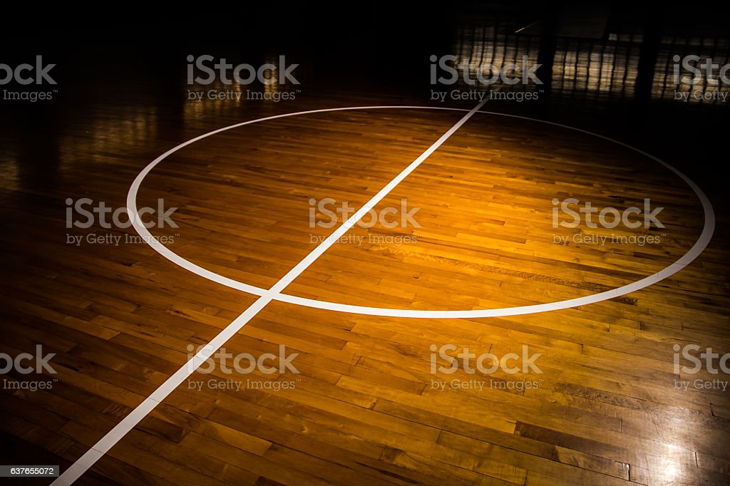 Wooden floor basketball court stock photo