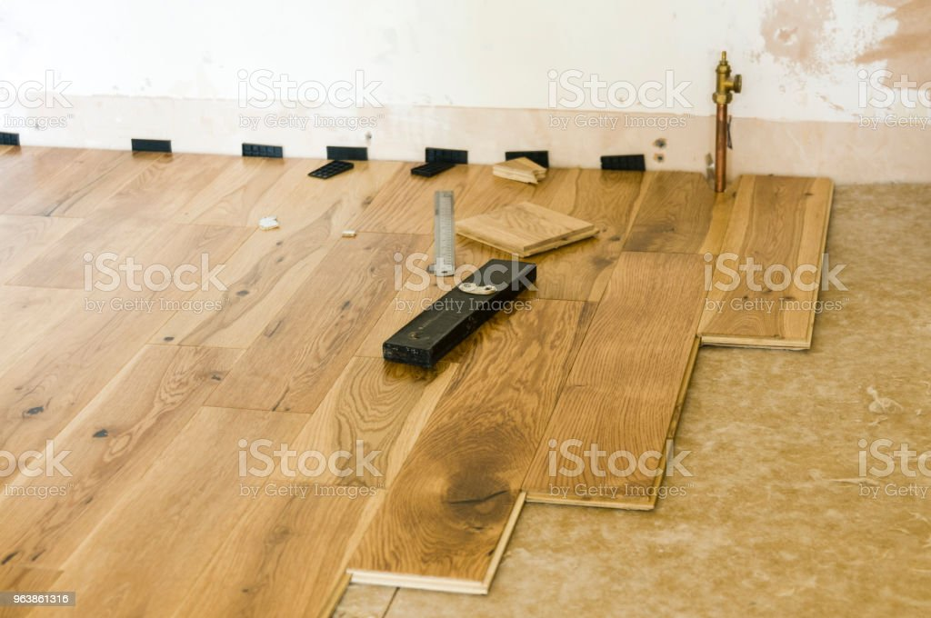 Wooden floor being laid - Royalty-free Built Structure Stock Photo