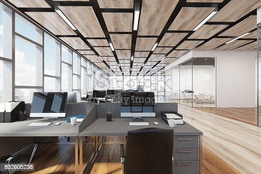 istock Wooden floor open space office, closeup 832605238