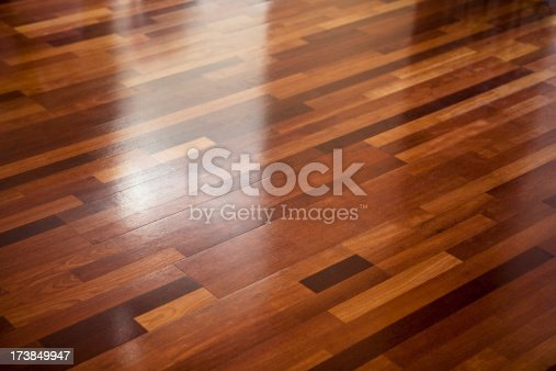 Polished wooden floor texture with diffuse reflections.