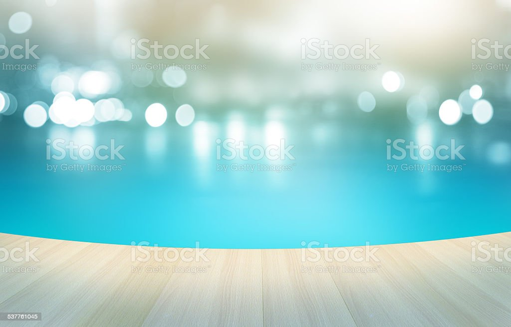 Wooden floor tropical swimming pool on pastel background, stock photo