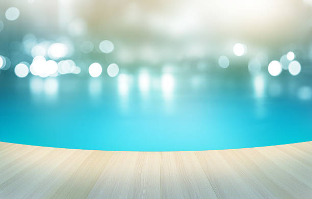 Wooden floor tropical swimming pool on pastel background, Wooden floor tropical swimming pool on pastel background, soft and blur concept poolside stock pictures, royalty-free photos & images