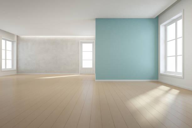 大家族、白いビンテージ ウィンドウ空ホールや自然光スタジオのドアにモダンな新しい家で大きな部屋に青い壁背景を持つ木製の床 ストックフォト