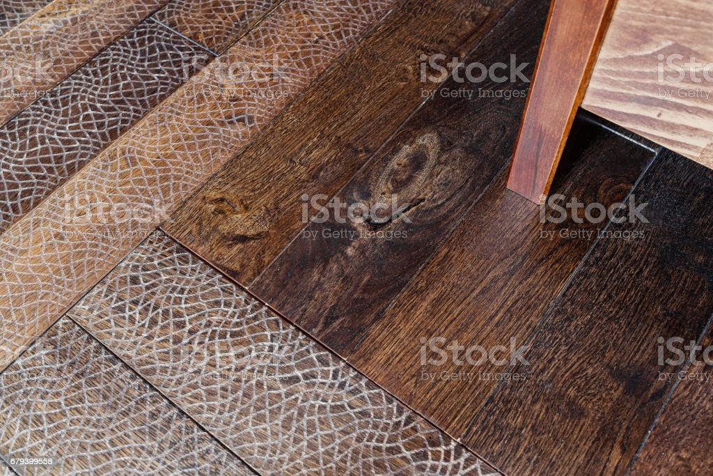 Wooden floor with embossing in interior. Wooden background. Brown grunge wood texture royalty-free stock photo