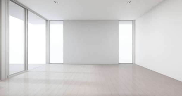 큰 가족, 유리 창과 빈 흰색 사무실 이나 자연 빛 스튜디오의 문을 대 한 현대 새 집 큰 방에 회색 콘크리트 벽을 배경으로 나무 바닥. - empty room 뉴스 사진 이미지
