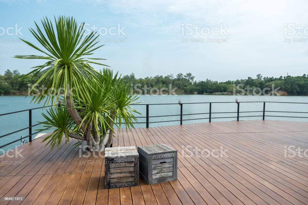 Wooden floor with lake view for outdoor activities or celebration royalty-free stock photo