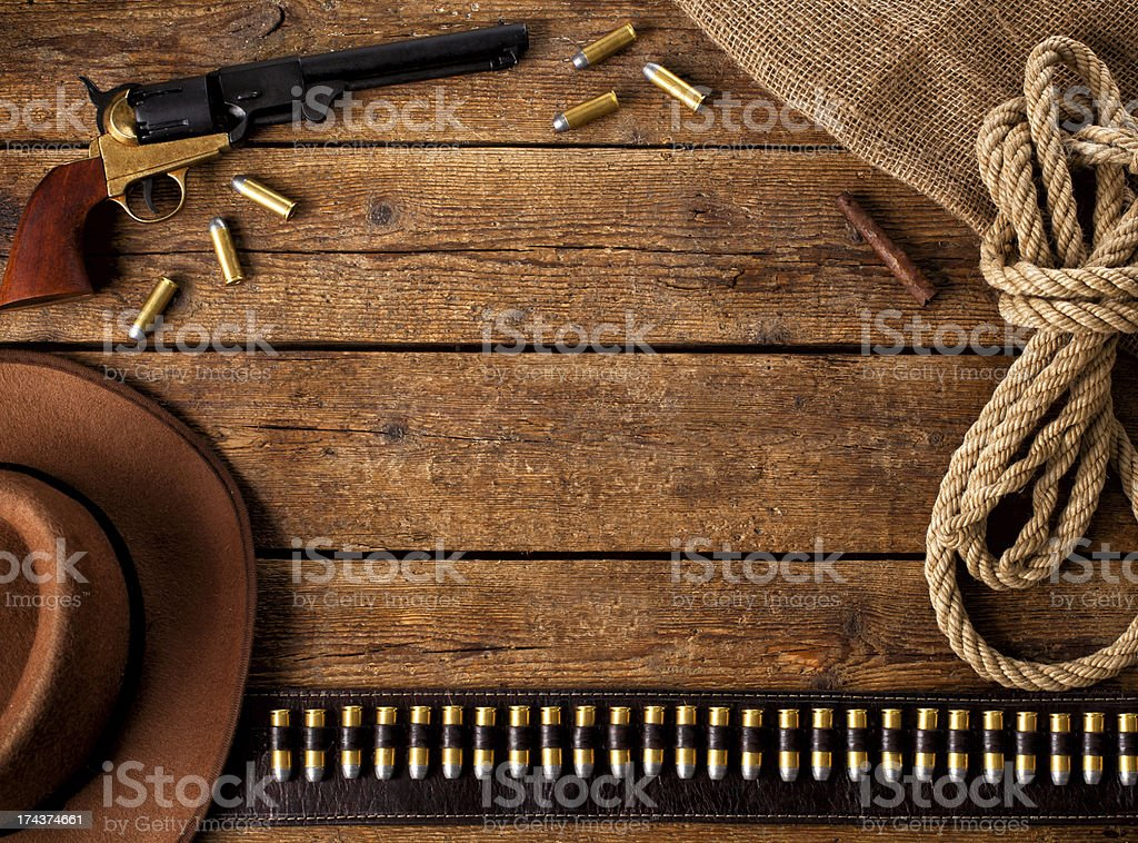A wooden floor with western accessories on it stock photo