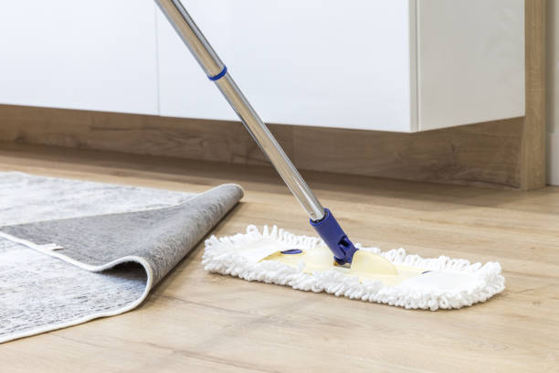 Wooden floor with white mop, cleaning service concept stock photo