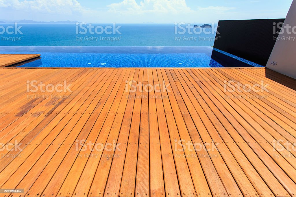 Wooden flooring beside the pool stock photo