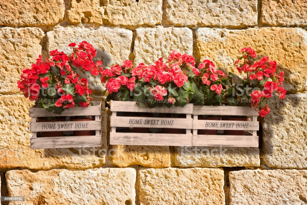 Wooden flowers boxes against an old brick wall - Home sweet home...
