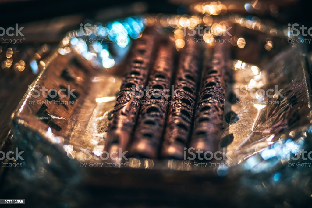 Wooden Flutes on Display in Low Light stock photo