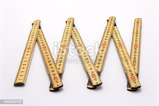 istock Wooden folding ruler isolated on a white background with a clipping path. 1049430752