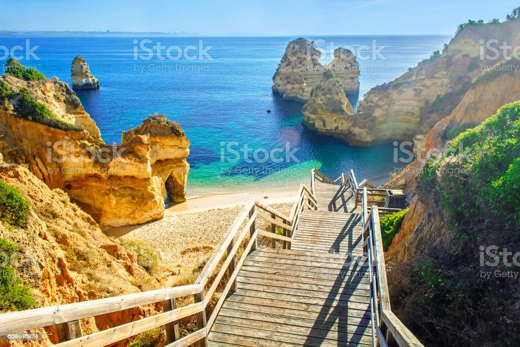 Wooden footbridge to beautiful beach Praia do Camilo near Lagos stock photo