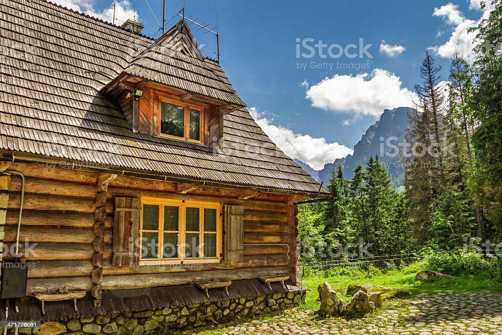 Wooden forester cottage in the mountains stock photo