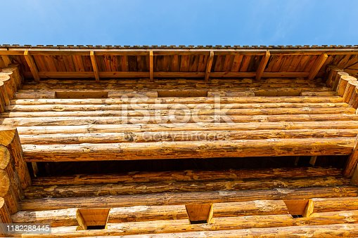 wooden fort wall building europe with tall windows rises against the sunny sky